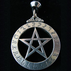 witches pendant with runes